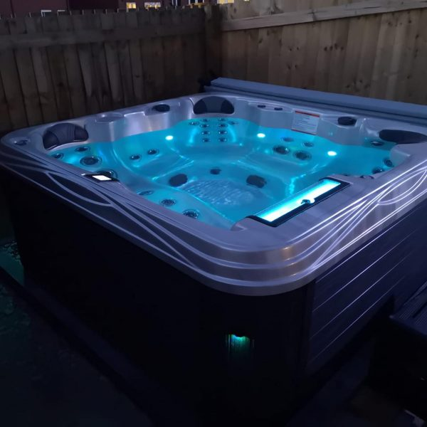 Hot Tub in a garden with a blue light